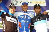 Tyler Farrar et Daniele Bennati entourent Tom Boonen sur Gand-Wevelgem
